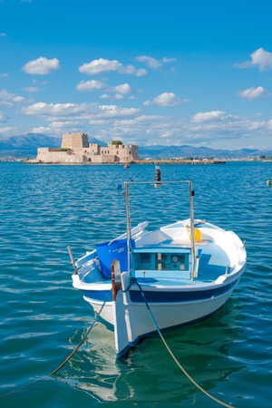 bourtzi: A boat and an old fortress island, in Nafplio, Peloponnese, Greece Editorial