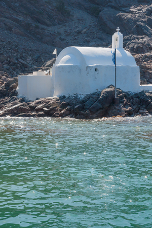 thira: A typical chapel on the coast, in Santorini Thira, Greece