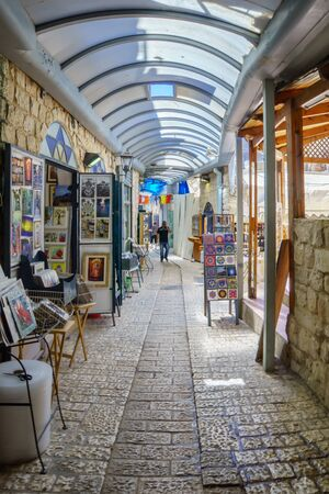 an ally: SAFED, ISRAEL - SEPTEMBER 18, 2015: An ally in the Jewish quarter, with local galleries and other businesses, locals and tourists, in Safed, Israel
