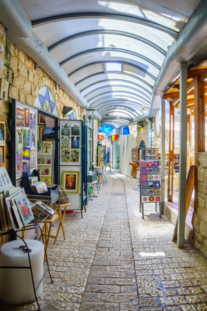 jewish town: SAFED, ISRAEL - SEPTEMBER 18, 2015: An ally in the Jewish quarter, with local galleries and other businesses, locals and tourists, in Safed, Israel