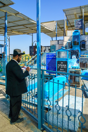 isaac: SAFED, ISRAEL - SEPTEMBER 18, 2015: Jewish man prays at the tomb of The ARI Rabbi Isaac Luria, in Safed, Israel