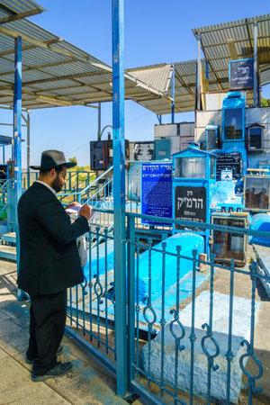 ari: SAFED, ISRAEL - SEPTEMBER 18, 2015: Jewish man prays at the tomb of The ARI Rabbi Isaac Luria, in Safed, Israel