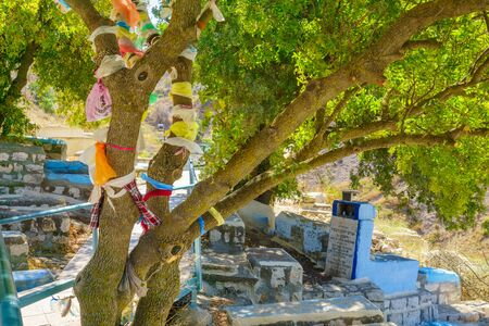 isaac: SAFED, ISRAEL - SEPTEMBER 18, 2015: A tree with traditional symbolic plastic bag attached, near the tomb of the ARI Rabbi Isaac Luria, in Safed, Israel