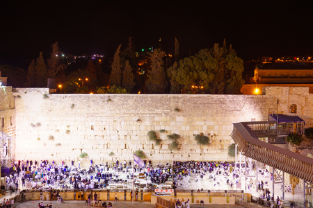JERUSALEM, ISRAEL - SEPTEMBER 21, 2015: Scene of the western wall crowded with Selichot Jewish penitential prays prayers, in the old city of Jerusalem, Israel