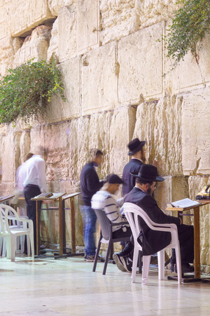 selichot: JERUSALEM, ISRAEL - SEPTEMBER 21, 2015: Jewish men pray Selichot Jewish penitential prays in the western wall, in the old city of Jerusalem, Israel