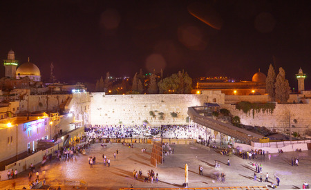 selichot: JERUSALEM, ISRAEL - SEPTEMBER 21, 2015: Scene of the western wall crowded with Selichot Jewish penitential prays prayers, in the old city of Jerusalem, Israel