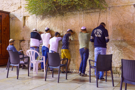 JERUSALEM, ISRAEL - SEPTEMBER 21, 2015: Jewish men pray Selichot Jewish penitential prays in the western wall, in the old city of Jerusalem, Israel