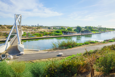 nahal: View of Hadera River Nahal Hadera Park and the Harp Nevel Bridge, Northern Israel. The sign describes the bridge and includes safety rules. Stock Photo