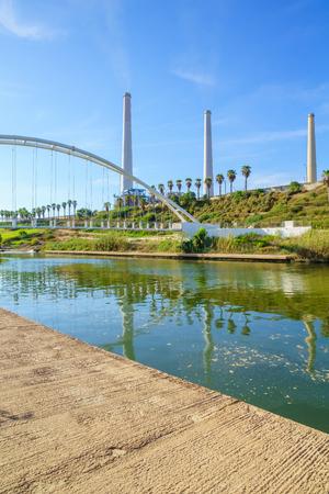 nahal: View of Hadera River Nahal Hadera Park, the Harp Nevel Bridge and the Harp Nevel Bridge, Northern Israel Stock Photo