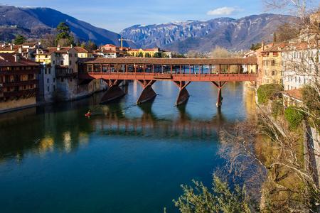 The Ponte Vecchio or Ponte degli Alpini bridge, and the Brenta river, in Bassano del Grappa, Veneto, Italy Stock Photo