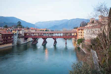 grappa: The Ponte Vecchio or Ponte degli Alpini bridge, and the Brenta river, on sunset, in Bassano del Grappa, Veneto, Italy