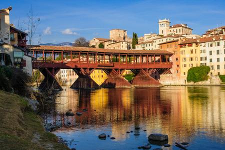 grappa: The Ponte Vecchio or Ponte degli Alpini bridge, and the Brenta river, in Bassano del Grappa, Veneto, Italy Stock Photo