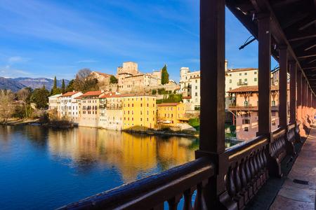 vechio: The Ponte Vecchio or Ponte degli Alpini bridge, and colorful houses on the Brenta river, in Bassano del Grappa, Veneto, Italy