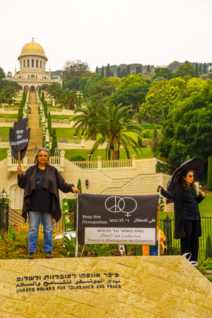 middle east war: HAIFA, ISRAEL - NOVEMBER 06, 2015: Group of Women in Black in anti-war and anti-occupation protests, in the German Colony, near the Bahai Gardens. Haifa, Israel Editorial