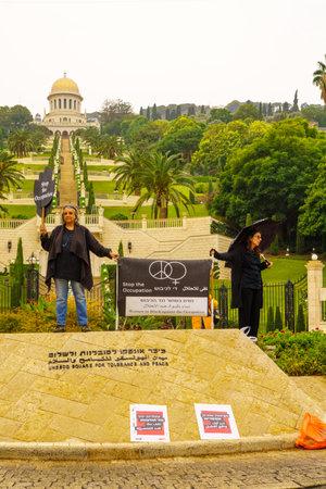 anti war: HAIFA, ISRAEL - NOVEMBER 06, 2015: Group of Women in Black in anti-war and anti-occupation protests, in the German Colony, near the Bahai Gardens. Haifa, Israel Editorial