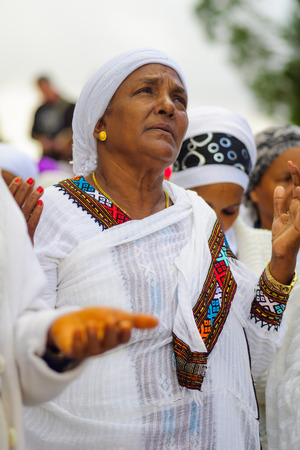 jewry: JERUSALEM, ISRAEL - NOVEMBER 11, 2015: An Ethiopian Jewish woman pray at the Sigd, in Jerusalem, Israel. The Sigd is an annual holiday of the Ethiopian Jewry