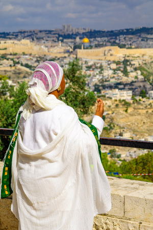 jewry: JERUSALEM, ISRAEL - NOVEMBER 11, 2015: An Ethiopian Jewish woman pray at the Sigd, facing the old city, in Jerusalem, Israel. The Sigd is an annual holiday of the Ethiopian Jewry Editorial