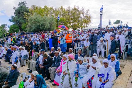 attend: JERUSALEM, ISRAEL - NOVEMBER 11, 2015: A crowd of Ethiopian Jews attend the Sigd, in Jerusalem, Israel. The Sigd is an annual holiday of the Ethiopian Jewry