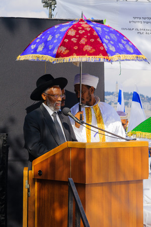 rabbi: JERUSALEM, ISRAEL - NOVEMBER 11, 2015: Rabbi Yosef Hadane the Ethiopian Chief Rabbi, speaks at the Sigd, in Jerusalem, Israel. The Sigd is an annual holiday of the Ethiopian Jewry