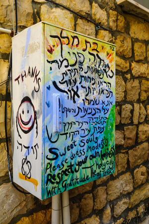 modesty: SAFED, ISRAEL - NOVEMBER 17, 2015: A communication box with a graffiti about modesty dress of women, in Safed Tzfat, Israel Editorial