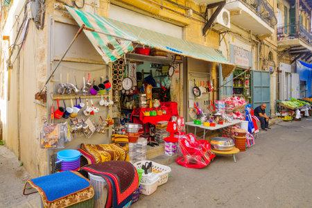 vadi: HAIFA, ISRAEL - NOVEMBER 28, 2015: Scene of Wadi Nisnas neighbourhood and its market, with local businesses, locals and tourists, in Haifa, Israel