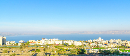 galilee: TIBERIAS, ISRAEL - DECEMBER 09, 2015: Panoramic view of the city and the Sea of Galilee, with locals and visitors, in Tiberias, Israel