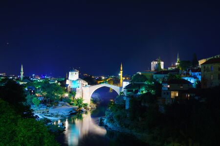 restored: The old city and the restored Old Bridge Stari Most at night, in Mostar, Bosnia and Herzegovina