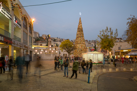 nazareth: NAZARETH, ISRAEL - DECEMBER 16, 2015: Christmas scene of Mary Well square, with the Greek Orthodox Church of the Annunciation, a Christmas tree, locals and tourists, in Nazareth, Israel Editorial