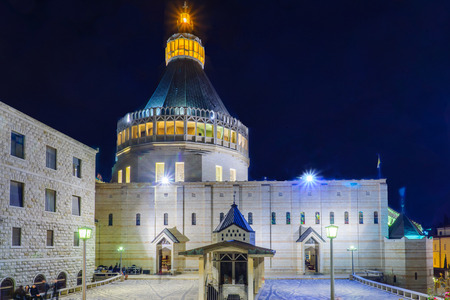 nazareth: NAZARETH, ISRAEL - DECEMBER 16, 2015: The Church of the Annunciation, at night, with locals and tourists, in Nazareth, Israel