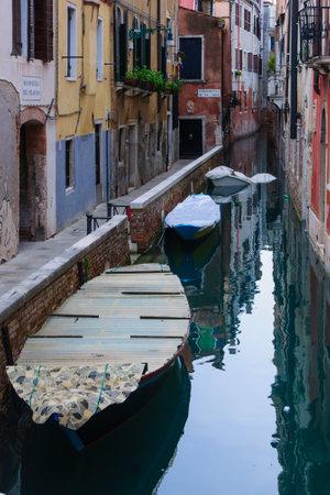veneto: VENICE, ITALY - FEB 04, 2015: Canals, boats and bridges in Venice, Veneto, Italy
