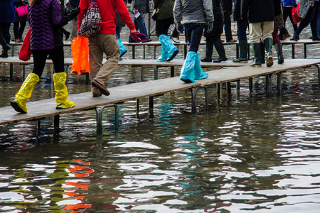 st  marks square: Boots and other footwear used in High water Acqua Alta in Venice, Veneto, Italy Stock Photo