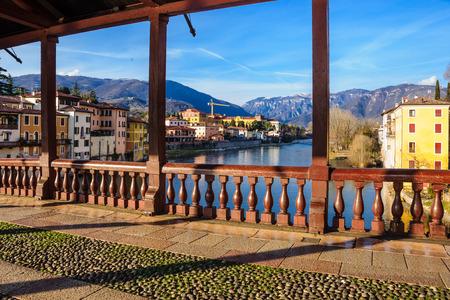 The Ponte Vecchio or Ponte degli Alpini bridge, and colorful houses on the Brenta river, in Bassano del Grappa, Veneto, Italy