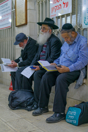 sephardic: NETIVOT, ISRAEL - JANUARY 13, 2016: Jewish men pray at the Rabbi Israel Abuhaseira Baba Sali tomb, as part of the annual hillula of his memory. In Netivot, Israel