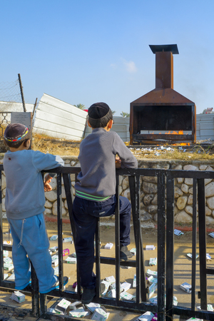 sephardic: NETIVOT, ISRAEL - JAN 13, 2016: Jewish kids looks at a furnace at the Rabbi Israel Abuhaseira Baba Sali tomb, as part of the annual hillula of his memory. Netivot, Israel