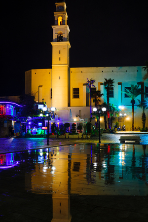 yafo: TEL-AVIV, ISRAEL - JANUARY 25, 2016: Night view of Kedumim square and the St. Peter Church, in the old city of Jaffa, Now part of Tel-Aviv Yafo, Israel
