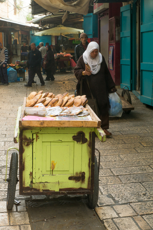 acre: ACRE, ISRAEL - JANUARY 18, 2016: Market scene in the old city, with sellers and shoppers, in Acre, Israel