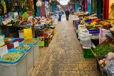 israel: ACRE, ISRAEL - JANUARY 18, 2016: Market scene in the old city, with sellers and shoppers, in Acre, Israel