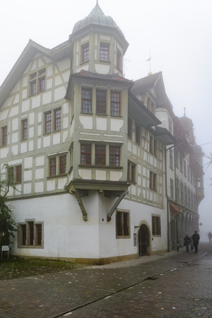 st gallen: ST. GALLEN, SWITZERLAND - JANUARY 01, 2016: Typical houses with oriel windows in the old town, with locals and visitors, in St. Gallen, Switzerland Editorial