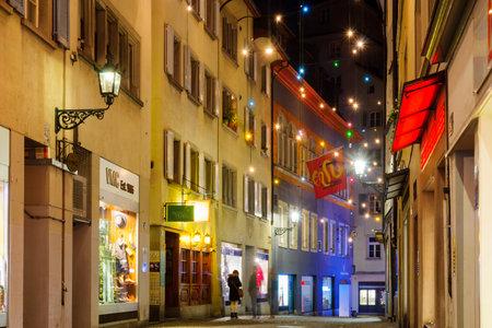 altstadt: ZURICH, SWITZERLAND - DECEMBER 24, 2015: Night street scene in the Old Town Altstadt, with Christmas decoration lamps in multiple colors, in Zurich, Switzerland Editorial