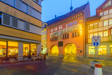 appenzeller: APPENZELL, SWITZERLAND - DECEMBER 30, 2015: Evening scene with painted houses, Christmas decorations,in Appenzell, Switzerland Editorial