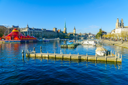 grossmunster cathedral: ZURICH, SWITZERLAND - DECEMBER 24, 2015: View of the Old Town Altstadt and the Limmat River, with locals and visitors. In Zurich, Switzerland