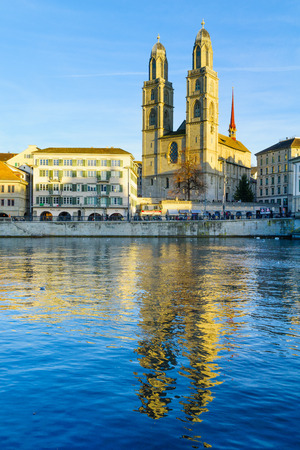 grossmunster cathedral: ZURICH, SWITZERLAND - DECEMBER 25, 2015: View of the Old Town Altstadt and the Limmat River, with the Grossmunster great minster Church, locals and visitors. In Zurich, Switzerland