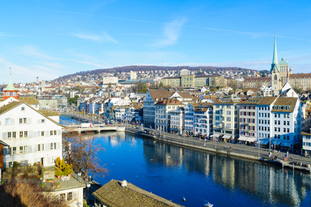 altstadt: ZURICH, SWITZERLAND - DECEMBER 24, 2015: View of the Old Town Altstadt, on the east bank of the Limmat River, with local businesses, locals and visitors. In Zurich, Switzerland Editorial