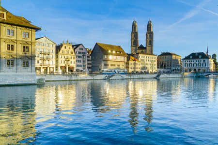 altstadt: ZURICH, SWITZERLAND - DECEMBER 25, 2015: View of the Old Town Altstadt and the Limmat River, with the Grossmunster great minster Church, locals and visitors. In Zurich, Switzerland