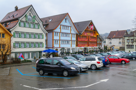 appenzeller: APPENZELL, SWITZERLAND - DECEMBER 31, 2015: The Landsgemeindeplatz open-air assembly square, with local businesses, locals and visitors, in Appenzell, Switzerland