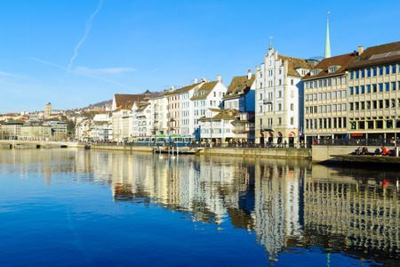 altstadt: ZURICH, SWITZERLAND - DECEMBER 27, 2015: View of the Old Town Altstadt, on the east bank of the Limmat River, with local businesses, locals and visitors. In Zurich, Switzerland