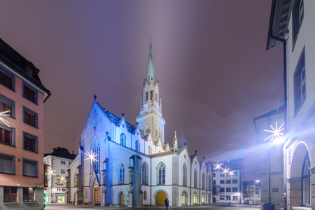 st gallen: ST. GALLEN, SWITZERLAND - JANUARY 01, 2016: Night view of the St. Laurenzen Kirche St. Lawrence Church, with Christmas decoration, locals and visitors, in St. Gallen, Switzerland