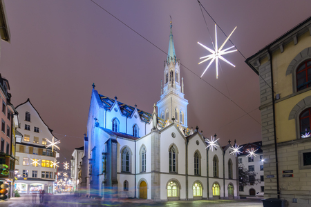 st gallen: ST. GALLEN, SWITZERLAND - JANUARY 01, 2016: Night view of the St. Laurenzen Kirche St. Lawrence Church, with Christmas decoration, in St. Gallen, Switzerland