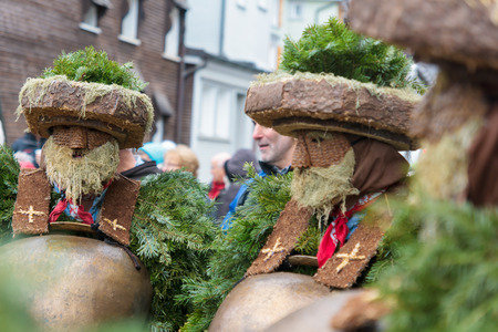 tradition: URNASCH, SWITZERLAND - DECEMBER 31, 2015: New Year Mummers, and spectators in Urnasch, Appenzell, Switzerland. Its part of the Silvesterchlausen tradition of greeting for the New Year