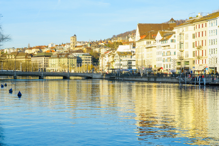 altstadt: ZURICH, SWITZERLAND - DECEMBER 25, 2015: View of the Old Town Altstadt, on the east bank of the Limmat River, with local businesses, locals and visitors. In Zurich, Switzerland